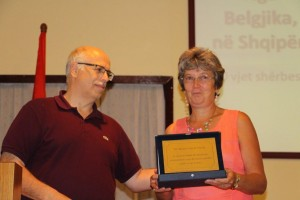 Ian Loring, the president of the Kenedi Foundation, gives Marleen a honoration award.